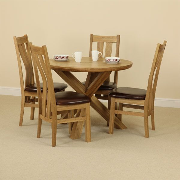 the solid oak round table with crossed legs and four