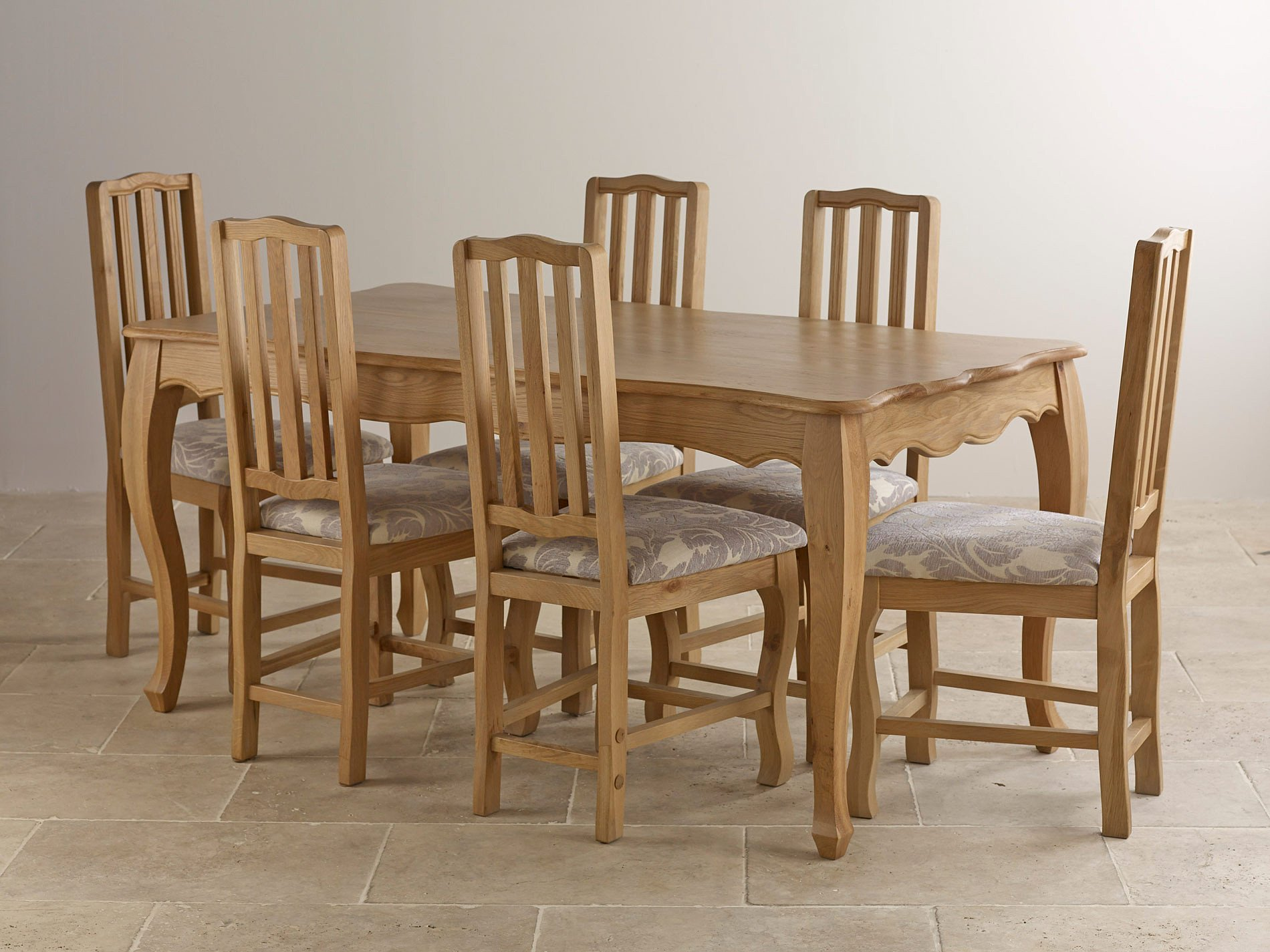 oak dining table with 6 solid oak and grey patterned dining chairs
