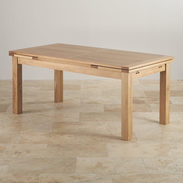 natural oak extending dining table seats up to 12 people extended