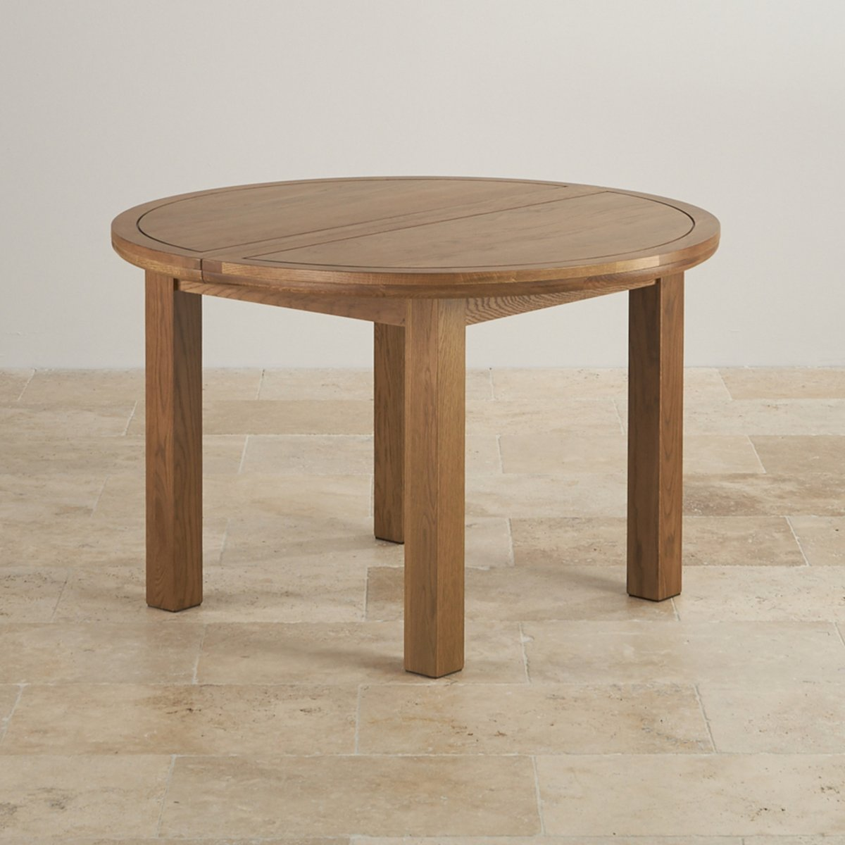 Round extending dining table in rustic oak oak furniture for Solid oak dining table