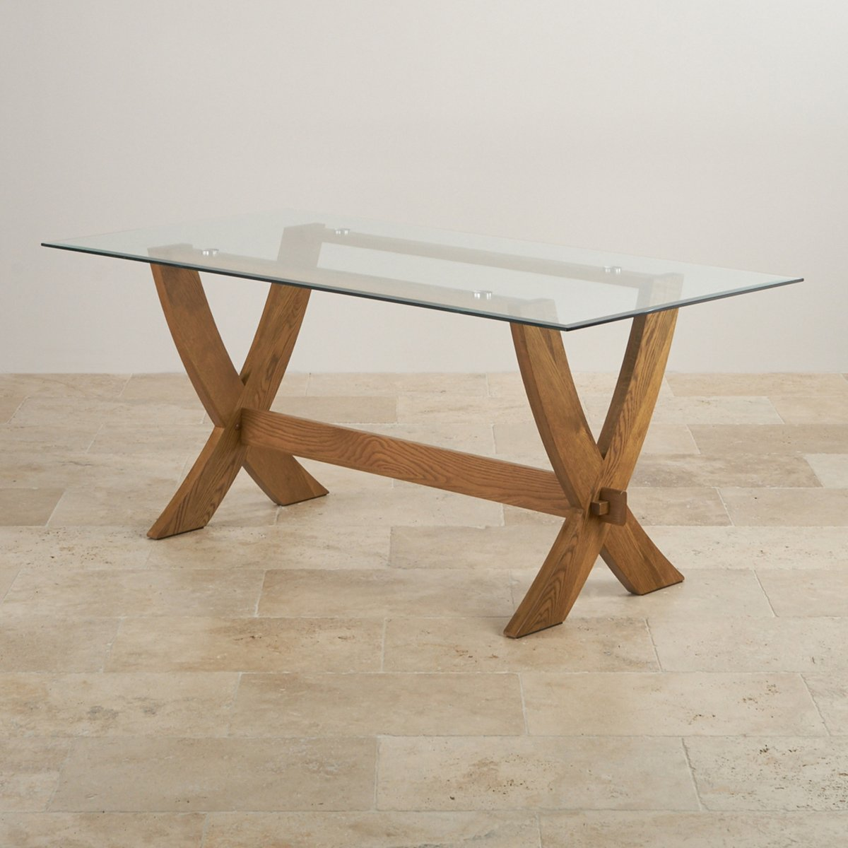 Reflection glass top dining table with solid oak crossed legs for Glass dining table