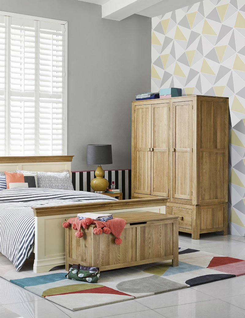 White and oak furniture with geometric wallpaper