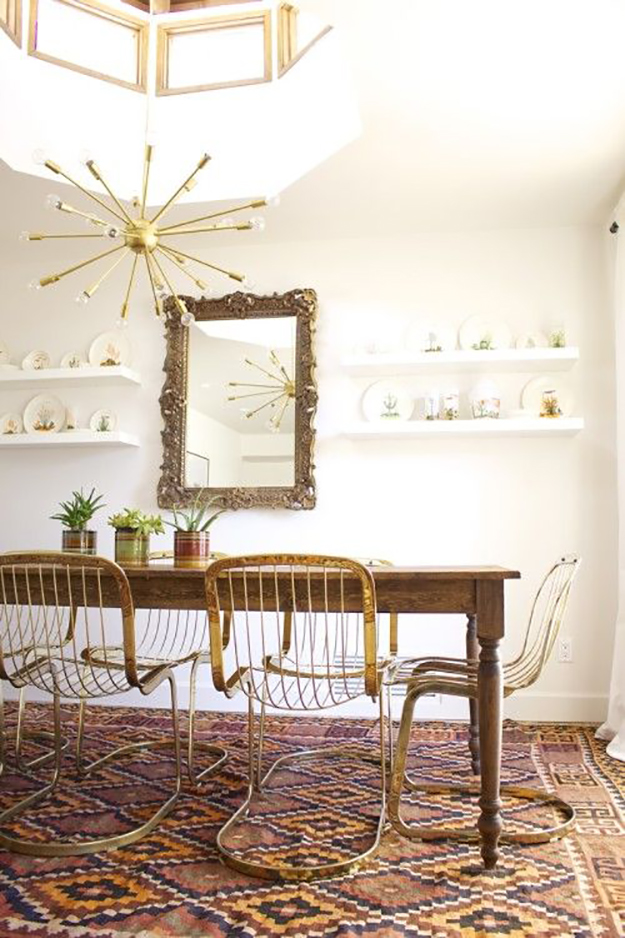 wood table brass chairs dining room