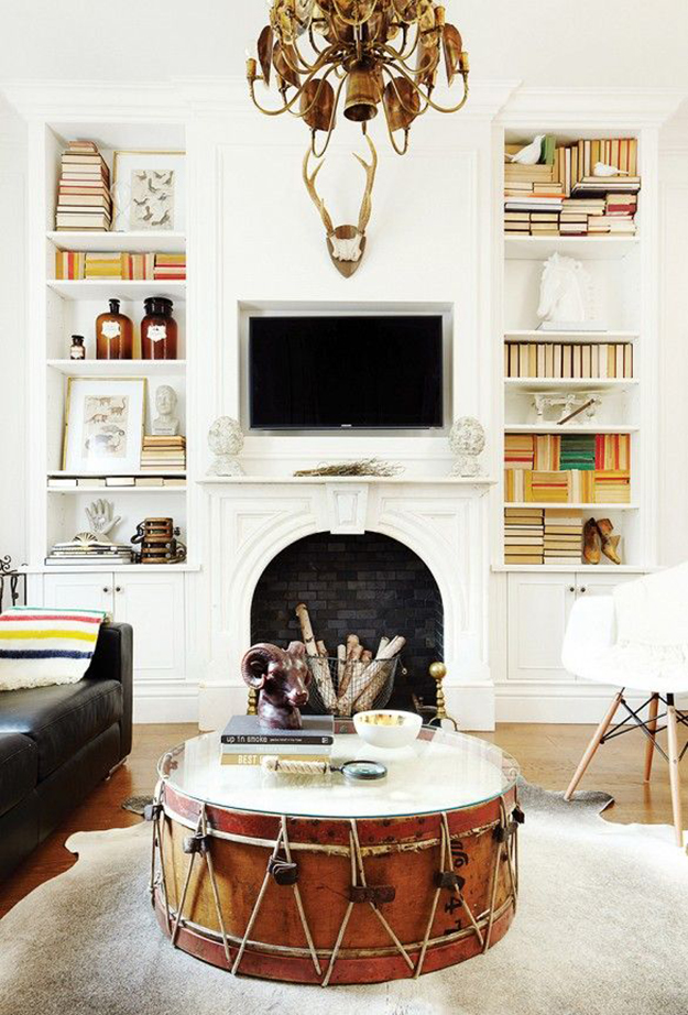 fireplace above mantle flanked with shelves