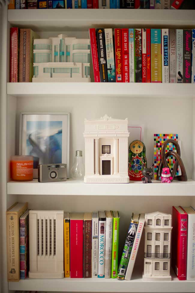 white shelves with books and trinkets