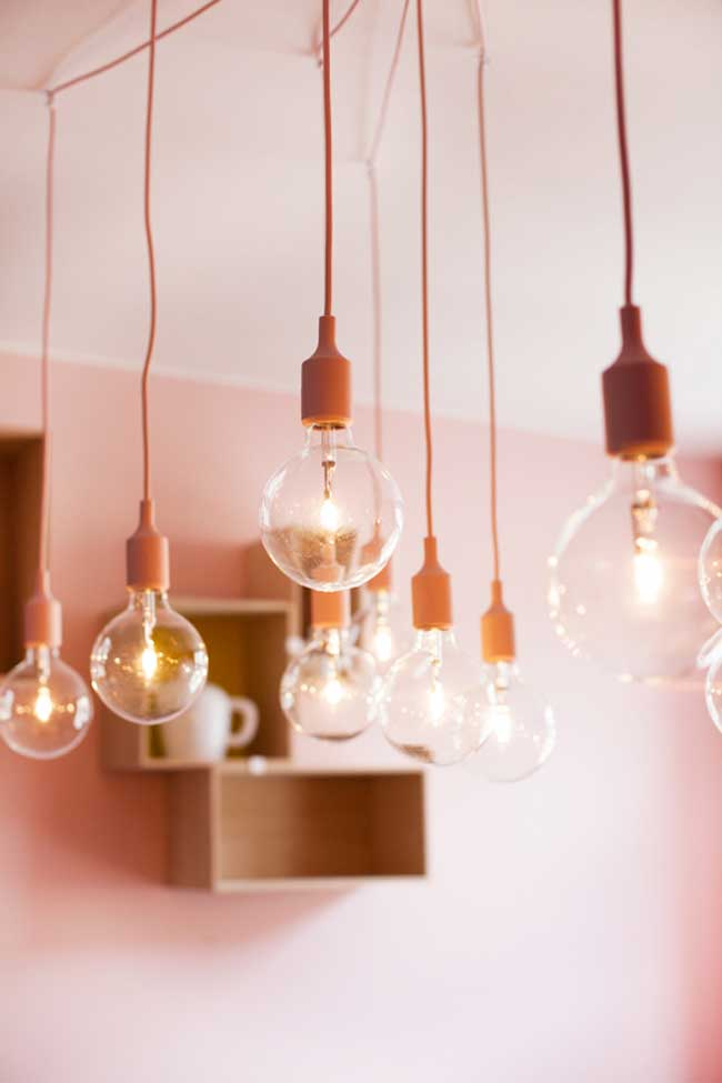 Lightbulbs hanging from ceiling in pink room