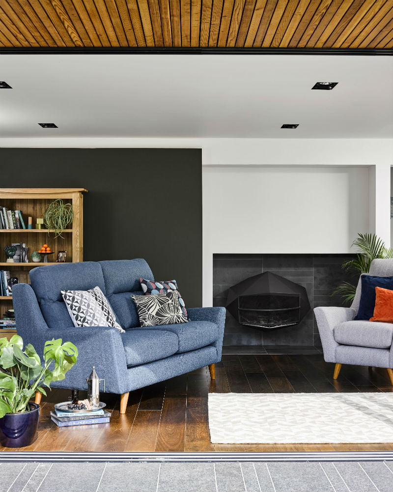 Living room furniture and black painted walls