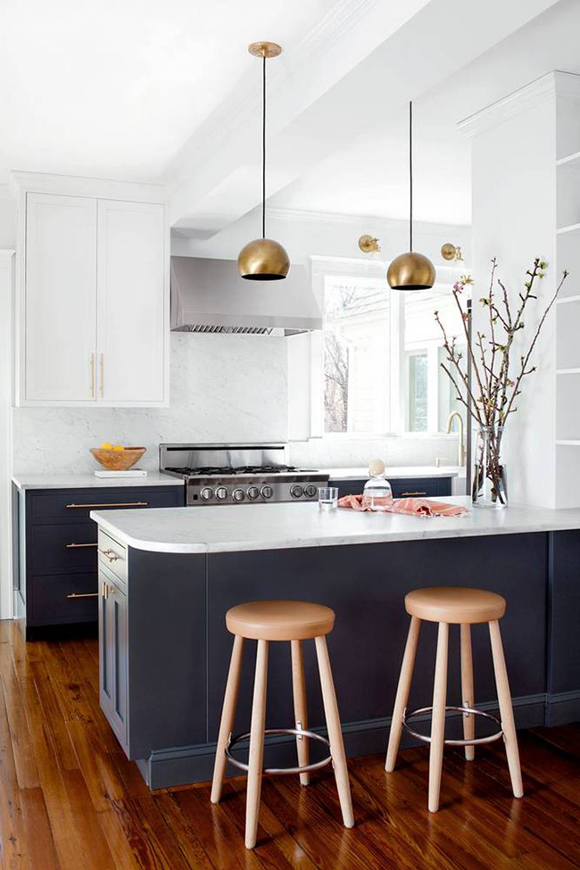 black and white kitchen with gold lighting