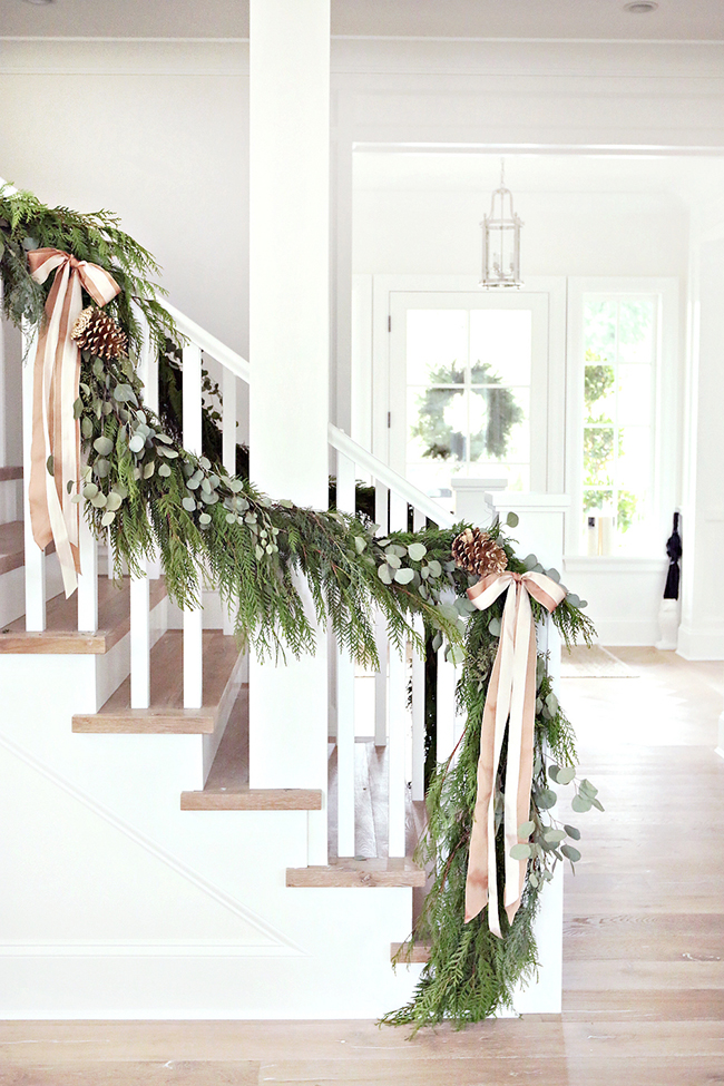 banister christmas with ribbon