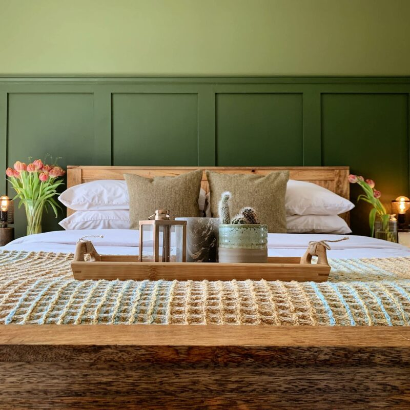 Cosy bedroom set up with tray on the bed