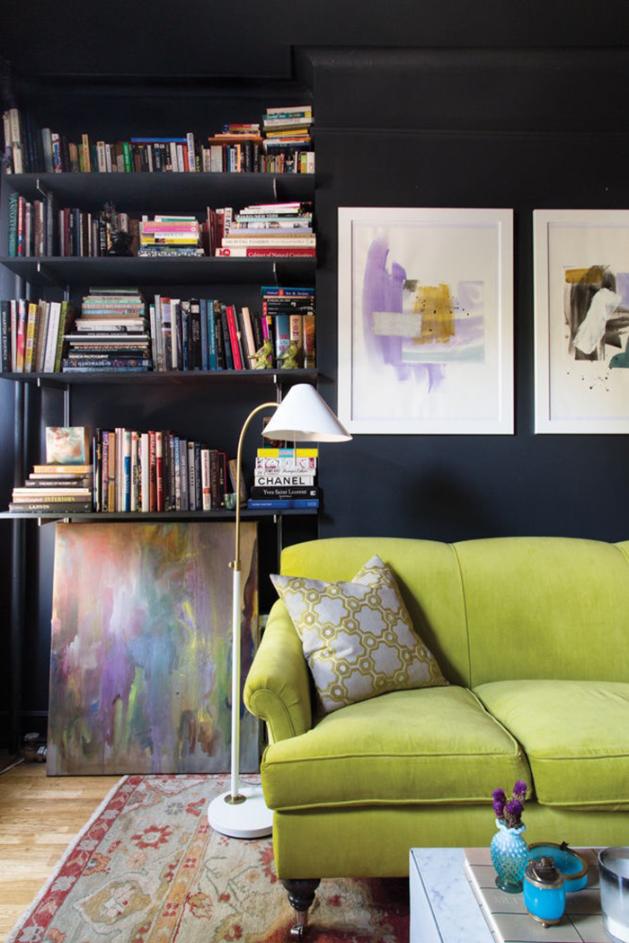 greenery sofa on dark walls with library