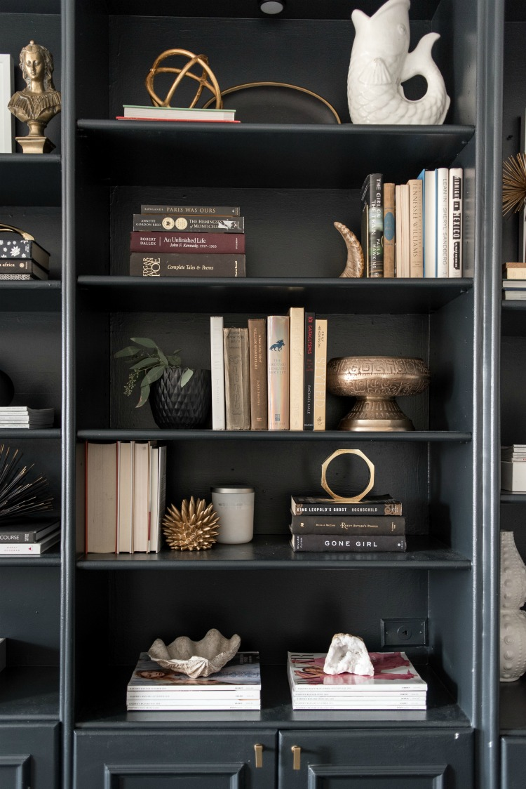 black bookshelves styled with objects