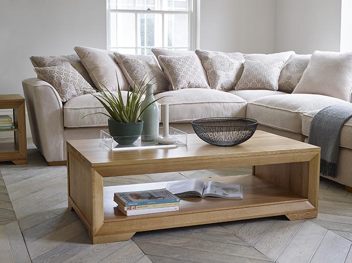 bevel coffee table with fabric corner sofa