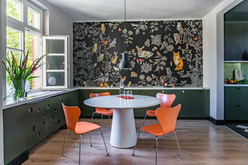 modern dining room with patterned wall paper