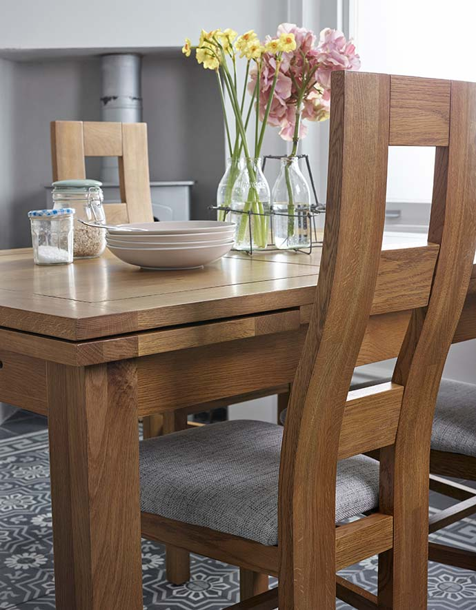 oak dining table with grey fabric dining chairs
