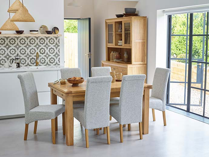 dorset dining table with grey fabric chairs