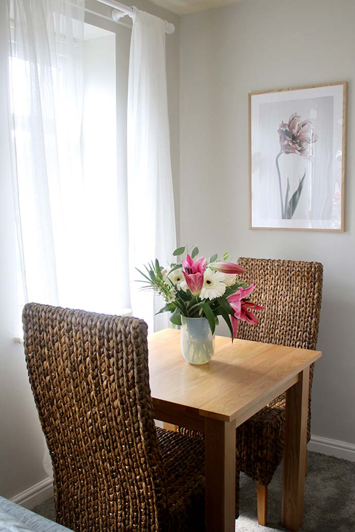 dining table and chairs in redecorated home