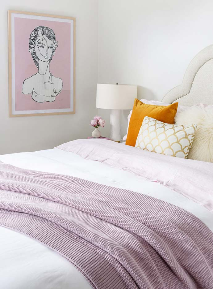 soft pink layered bedroom with gold cushion
