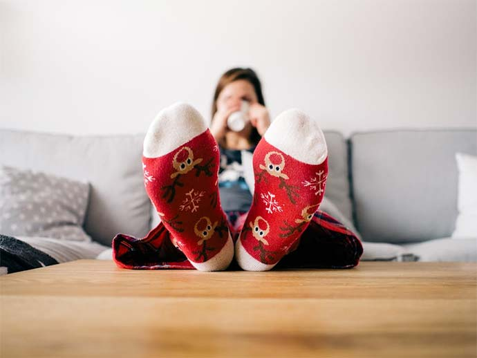relaxing on sofa with christmas socks