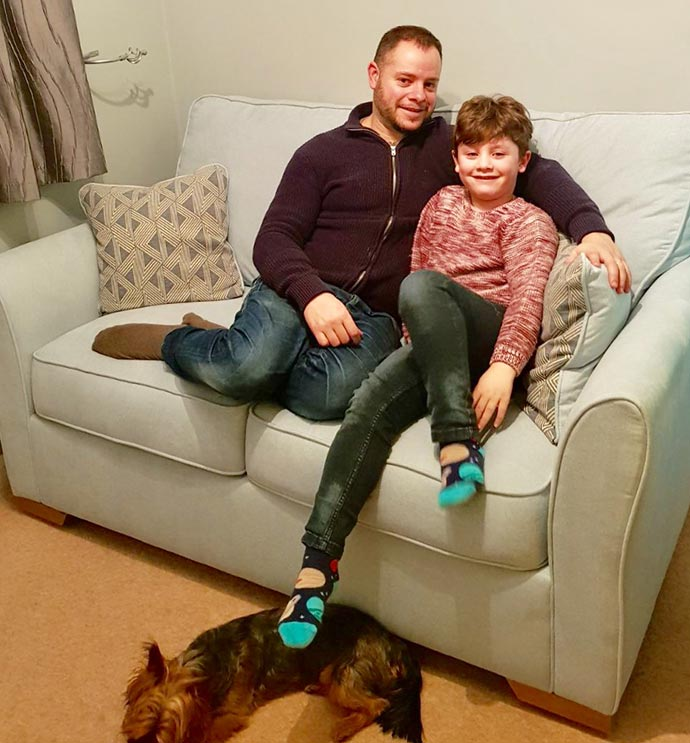 rob nathan competition winner and son on sofa bed