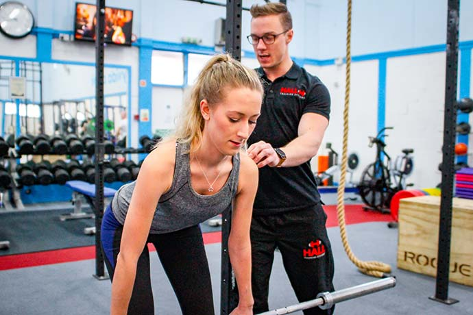 woman deadlift with personal trainer