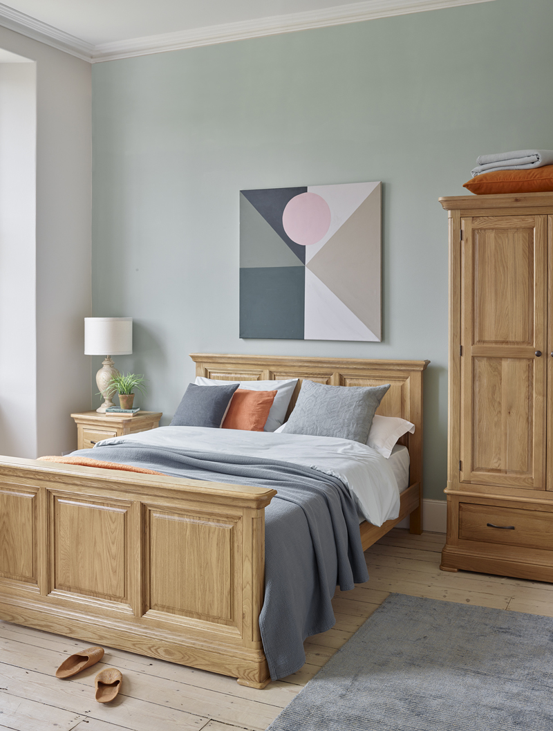 Wooden bedroom furniture with dusky toned accessories