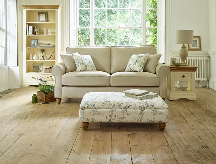 country cottage style living room with floral footstool