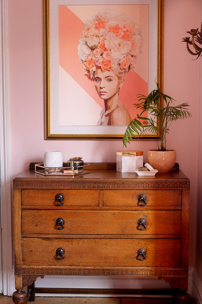 1930s inspired furniture with photo frame on wall