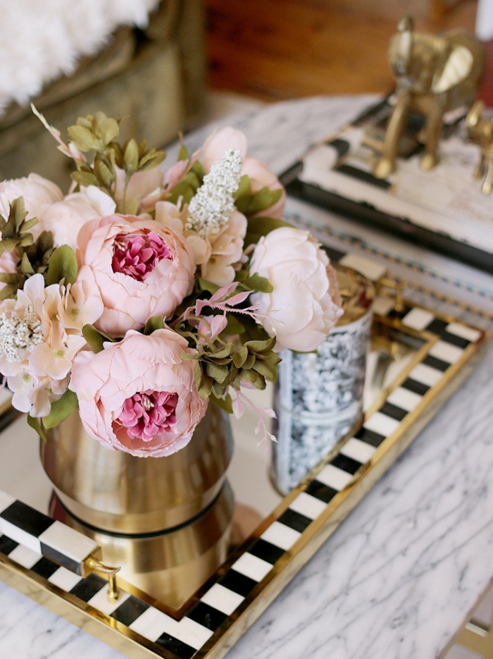Peonies on a gold tray and trendy finishes