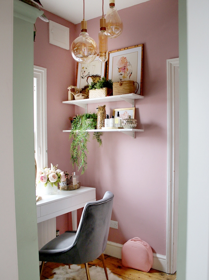 Pink vanity space with white features