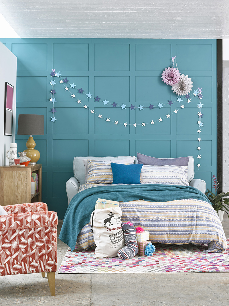Sofa Bed, Blue panel walls, star bunting