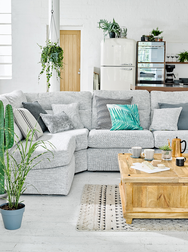 Grey Sofa with Botanical themed cushions