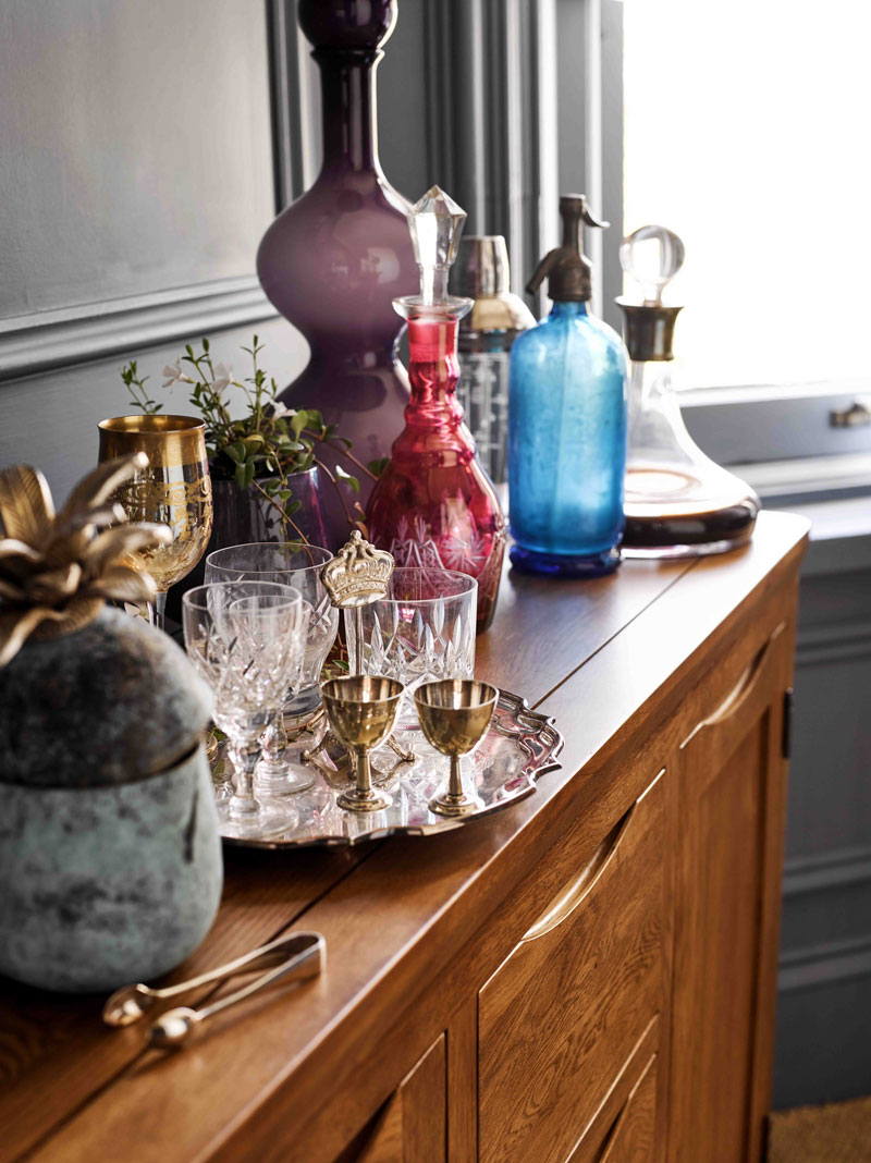 Storage cabinets and sideboards can be used for surface space during Christmas parties as a bar area to serve your festive drinks