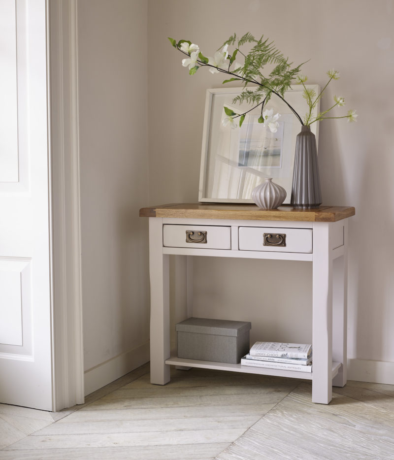 grey painted console table with neutral accessories