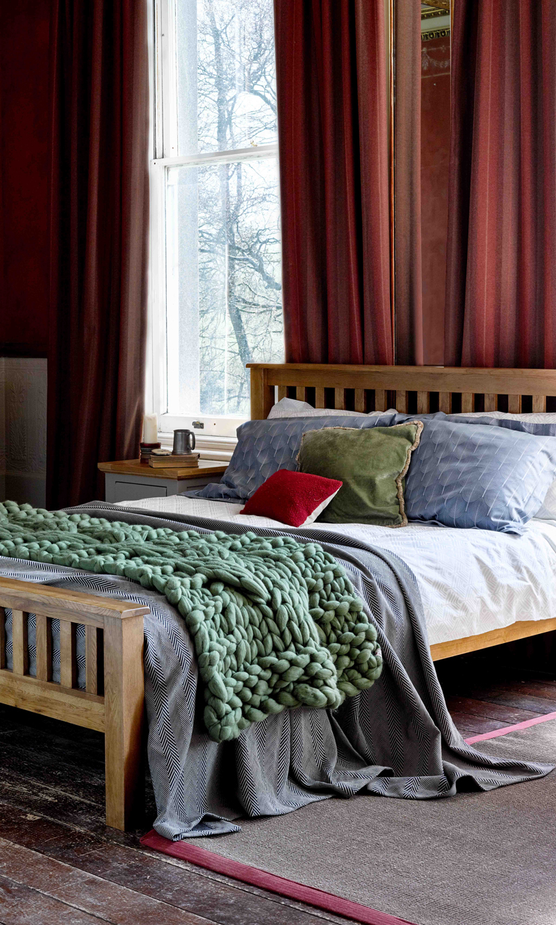 Bed with red Curtains
