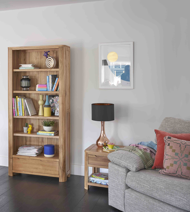 Bookcase with colourful accessories
