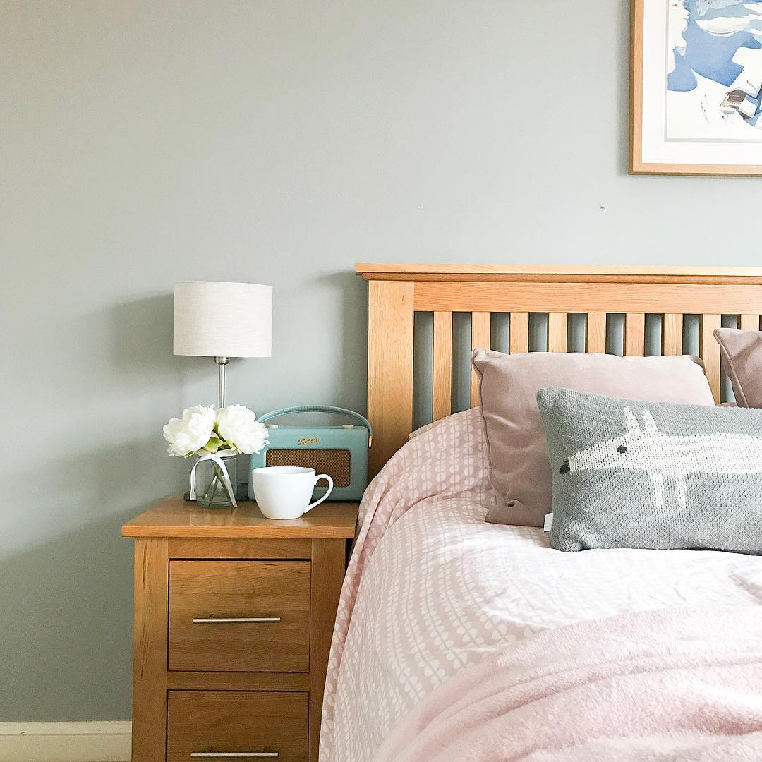 Pastel tone accessories on an oak bed