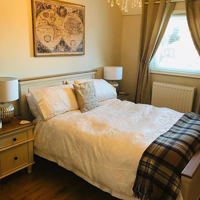 Warm toned bedroom furniture with a neutral colour scheme