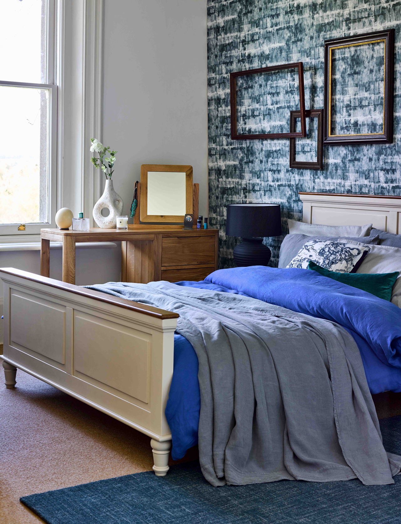 statement wallpaper and blue grey bedroom decor