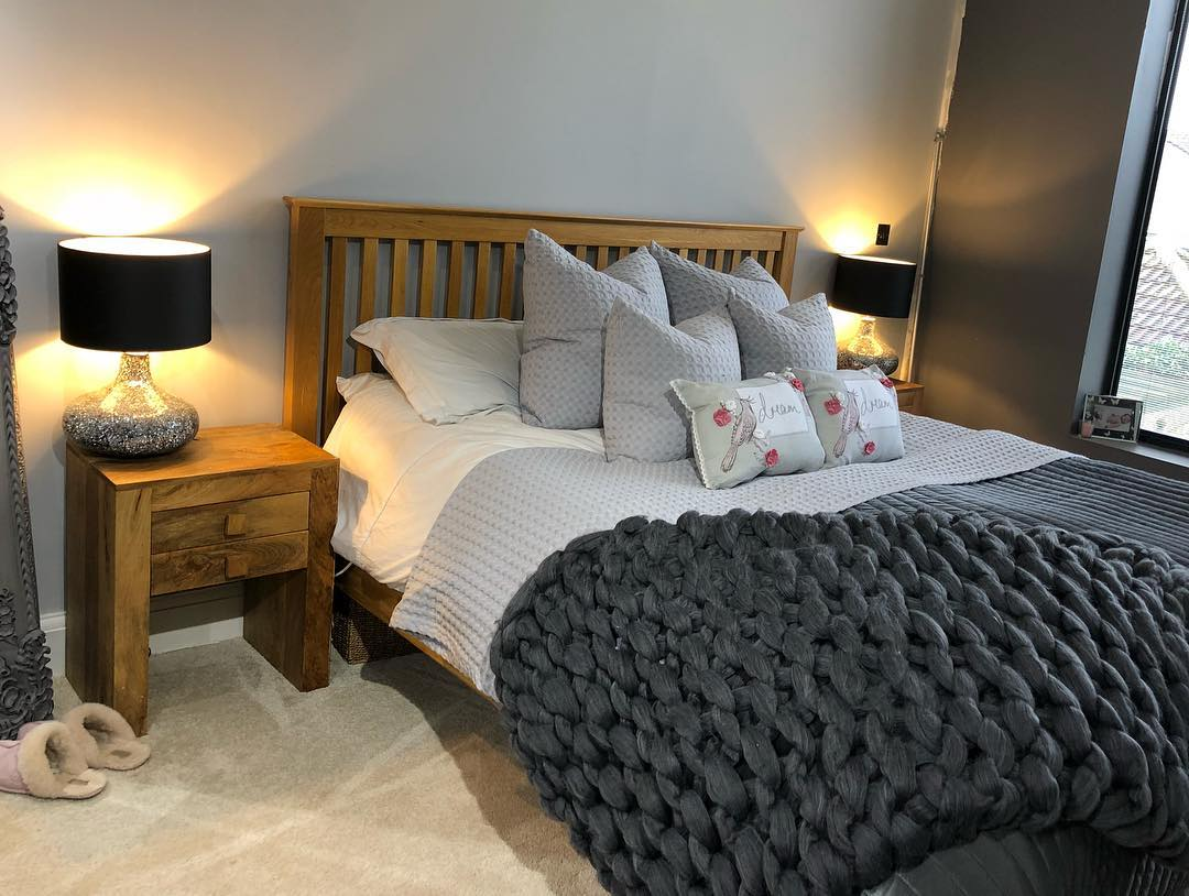 Warm toned oak bedroom furniture with a grey colour scheme