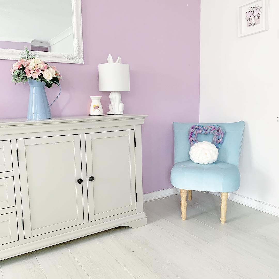 Arlette Sideboard, pink walls. blue chair.