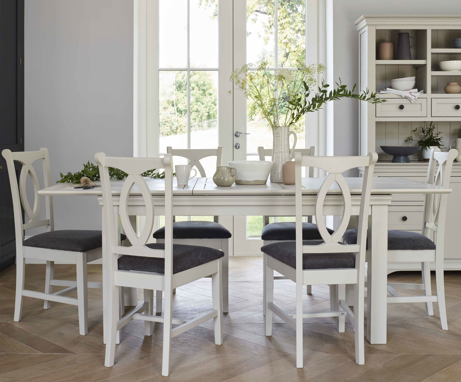 Arlette White Dining Table with flowers