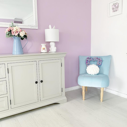 Arlette Sideboard, pink walls. blue chair.
