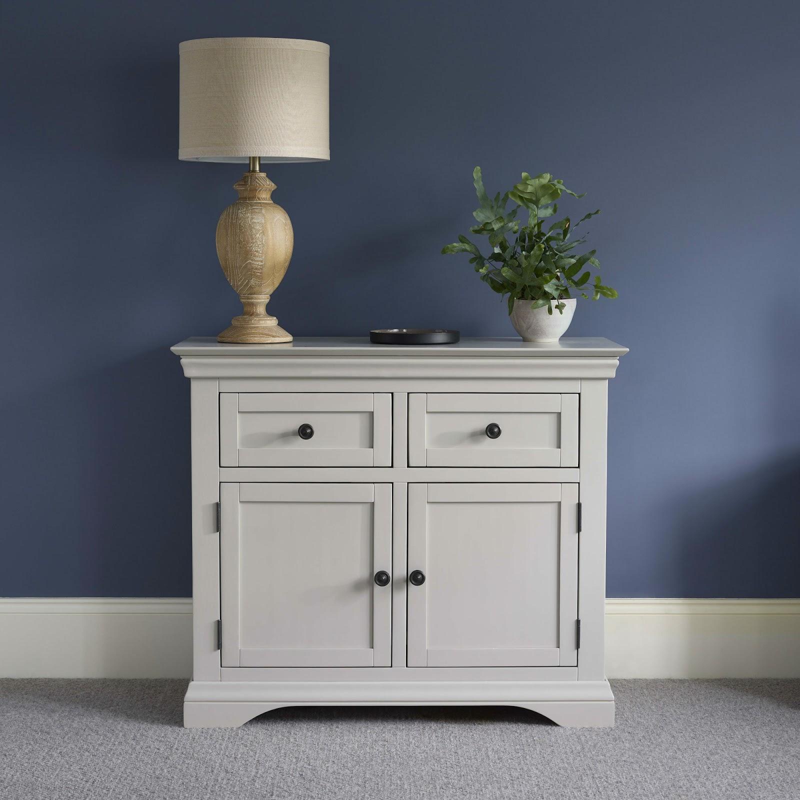 White Furniture and dark blue walls