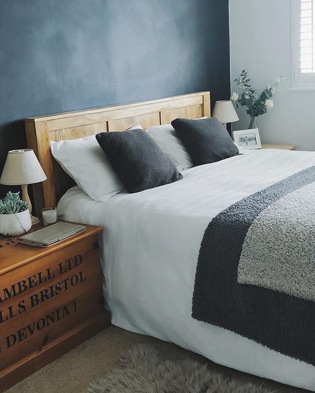 Wooden Bedroom Furniture with dark bedding