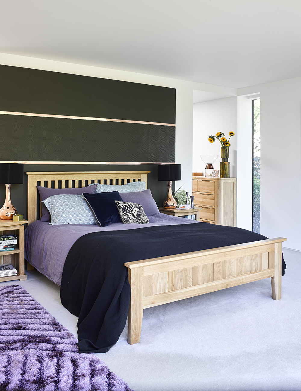 Bedroom with purple bedding and black walls