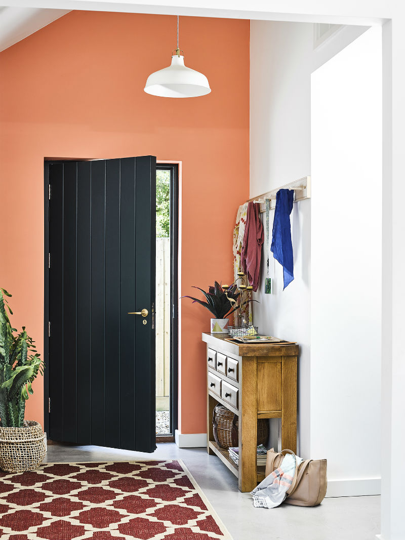 a hallway with terracotta paint,