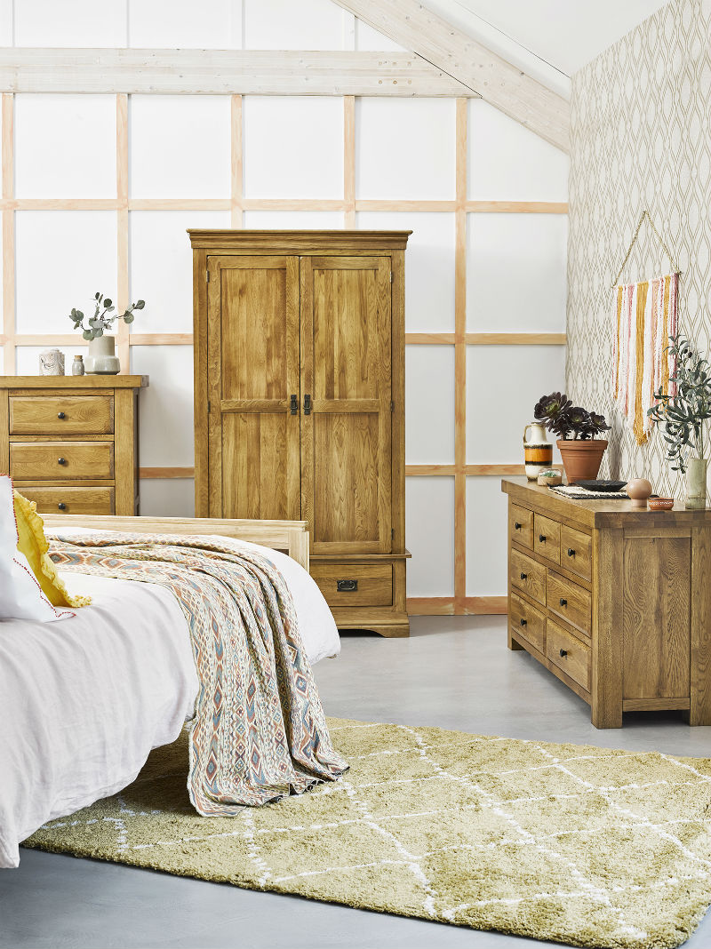 a bedroom with oak furniture