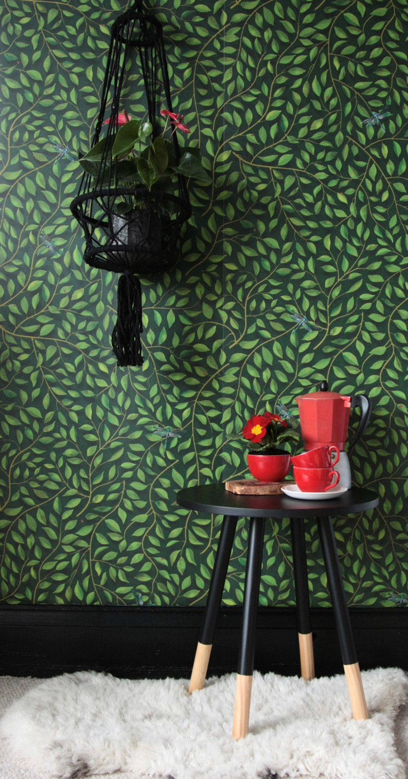 Green floral wallpaper with black table