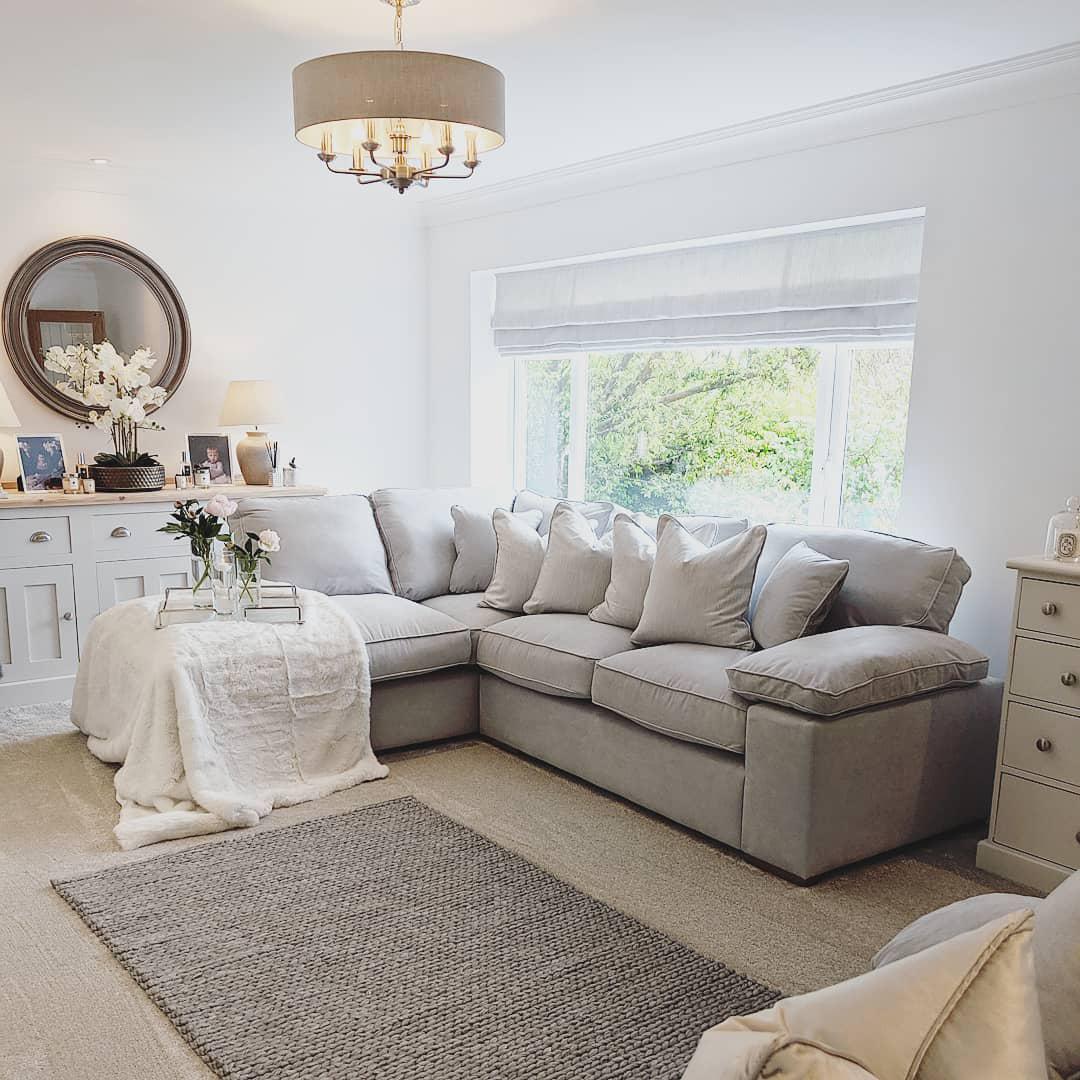 silver sofa with white accessories